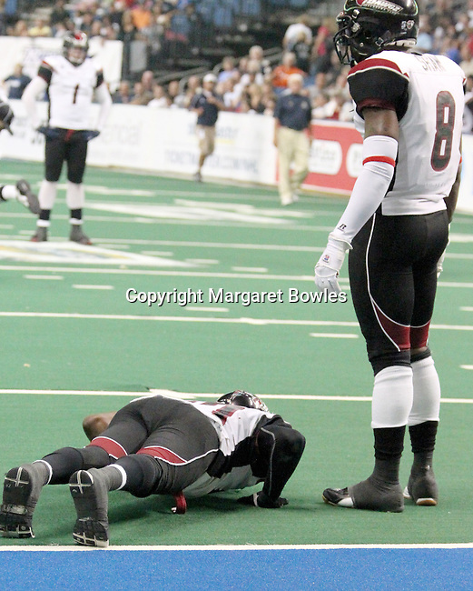 05 June 2010: Oklahoma City defensive lineman Tim McGill watches as teammate Brandon Hefflin punishes himself with push-ups after the Oklahoma City defense allowed Tampa Bay to score to go ahead in the fourth quarter. The Tampa Bay Storm defeated the Oklahoma City Yard Dawgz 50-48 at the St. Pete Forum in Tampa, Florida