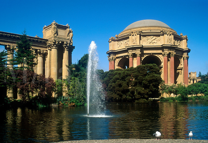 Exterior architecture of Exhibition Hall; pond and water fountain in the foreground. San Francisco, California.