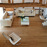 An aerial view of the living room with matching pairs of leather sofas and Barcelona chairs