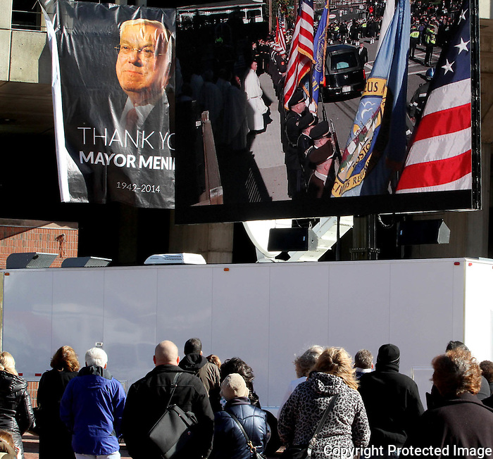 A small gathering watched the Mass on a large screen outside Boston City Hall for the Thomas Menino's funeral procession on November 3, 2014.<br /> (Photo by Gary Wilcox)