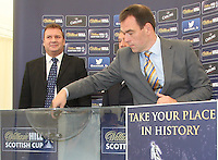 Kristof Fahy drawing the ball assigned to Alloa Athletic, drawn away to Rangers. Scottish FA President Campbell Ogilvie joined by former Rangers and Scotland striker Derek Johnstone and Kristof Fahy, Chief Marketing Officer at William Hill, in conducting the draw for Round 3 of the William Hill Scottish Cup which took place at Hamilton Park Racecourse on 1.10.12