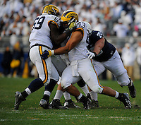 21 November 2015:  Michigan DE Willie Henry (69) and DT Chris Wormley (43) sandwich and sack Penn State QB. The Michigan Wolverines defeated the Penn State Nittany Lions 28-16 at Beaver Stadium in State College, PA. (Photo by Randy Litzinger/Icon Sportswire)