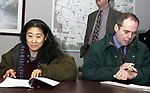 Newsday reporters Emi Endo and Robert Keeler covering a press conference by New York State Assemblyman Steve Levy at the Offices of Nationwide Risk Management in Bohemia on Monday January 20, 2003, at which Levy outlined the platform for his campaign for Suffolk County Executive. (Newsday photo by Jim Peppler).