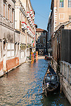 Gondola on the narrow canals in Venice, Italy