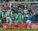 13.05.2018 Hibs v Rangers: Jamie Maclaren puts the ball past Russell martin to score no 5 for Hibs in added on time