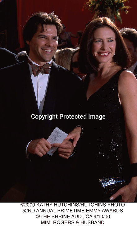 ©2000 KATHY HUTCHINS/HUTCHINS PHOTO.52ND ANNUAL PRIMETIME EMMY AWARDS.@THE SHRINE AUD., CA 9/10/00.MIMI ROGERS & HUSBAND