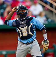 Julio Rodriguez (21) of the Northwest Arkansas throws to first base Naturals during a game against the Springfield Cardinals at Hammons Field on June 14, 2012 in Springfield, Missouri. (David Welker/Four Seam Images).