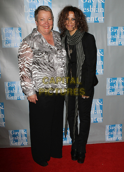 "LORRI L. JEAN & LINDA PERRY.L.A. Gay & Lesbian Center's ""An Evening With Women"" held at The Beverly Hilton Hotel, Beverly Hills, California, USA..April 16th, 2011.full length  black suit jacket jeans denim grey gray scarf white sheer top.CAP/ADM/KB.©Kevan Brooks/AdMedia/Capital Pictures."