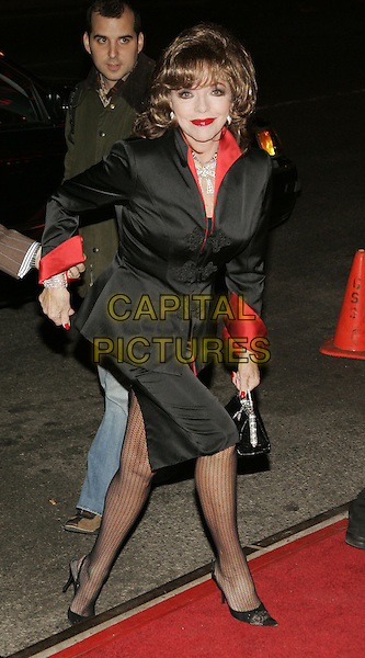 """JOAN COLLINS.""""Basic Instinct 2"""" NY Premiere at Loews Lincoln Square Theatre, New York, NY, USA..March 27th, 2006.Photo: Jackson Lee/Admedia/Capital Pictures.Ref: JL/ADM.full length black skirt jacket red walking .www.capitalpictures.com.sales@capitalpictures.com.© Capital Pictures."""
