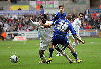 ATTENTION SPORTS PICTURE DESK<br /> Pictured L-R: Nathan Dyer of Swansea is tackled by Craig Bellamy of Cardiff.<br /> Re: npower Championship Swansea City FC v Cardiff City FC at the Liberty Stadium, south Wales. Sunday 06 February 2011