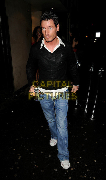 DEAN GAFFNEY.The Neon Management weekly club night launch party, Vendome bat & nightclub, Piccadilly, London, England..January 28th, 2009.full length black top denim jeans red bull can drink beverage .CAP/CAN.©Can Nguyen/Capital Pictures.