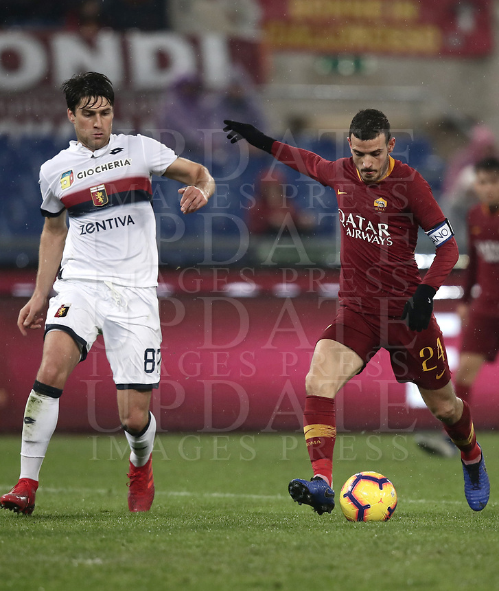 Football, Serie A: AS Roma - Genoa, Olympic stadium, Rome, December 16, 2018. <br /> Roma's captain Alessandro Florenzi (r) in action with Genoa's Ervin Zukanovic (l) during the Italian Serie A football match between Roma and Genoa at Rome's Olympic stadium, on December 16, 2018.<br /> UPDATE IMAGES PRESS/Isabella Bonotto