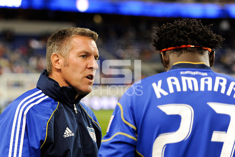 Kansas City Wizards head coach Peter Vermes talks with Kei Kamara (23). The New York Red Bulls defeated the Kansas City Wizards 1-0 during a Major League Soccer (MLS) match at Red Bull Arena in Harrison, NJ, on October 02, 2010.