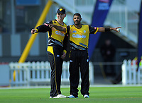 Wellington's Michael Bracewell with Jeetan Patel during the Dream11 Super Smash T20 cricket match between the Wellington Firebirds and Central Stags at Basin Reserve in Wellington, New Zealand on Thursday, 18 December 2019. Photo: Dave Lintott / lintottphoto.co.nz