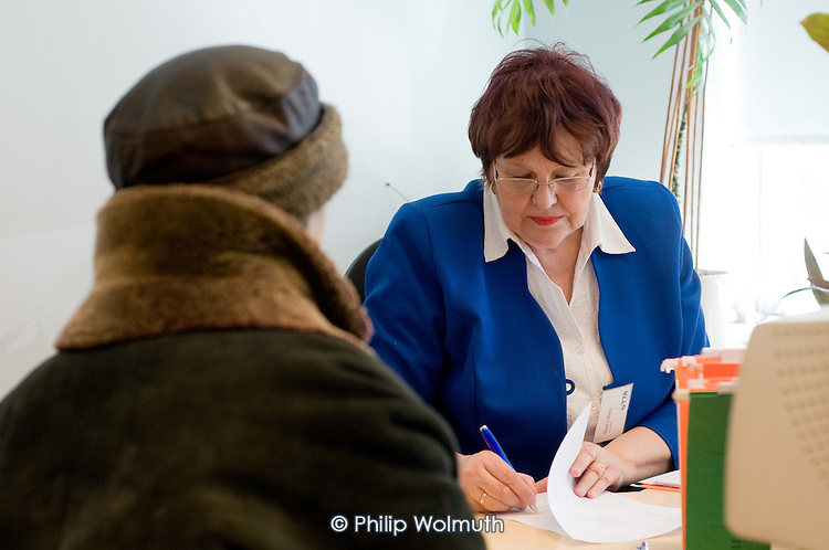 An adviser talks to a job-seeker at the Tallinn Labour Market Board (unemployment office).  Estonia has been badly hit by the economic crisis.