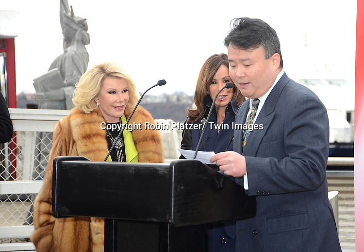 "Joan Rivers and Melissa Rivers and David W Chien  honored by Gray Line New York with a ""Ride of Fame"" bus with their name on a decal in the front of the bus on March 1, 2013 at Pier 78 in New York City."