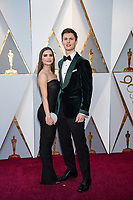 Violetta Komyshan and Ansel Elgort arrive on the red carpet of The 90th Oscars&reg; at the Dolby&reg; Theatre in Hollywood, CA on Sunday, March 4, 2018.<br /> *Editorial Use Only*<br /> CAP/PLF/AMPAS<br /> Supplied by Capital Pictures