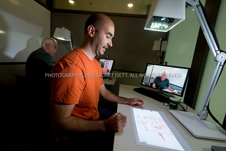 """9/4//2012--Redmond, WA, USA..Sasa Junuzovic, a research engineer, works on 'Illumishare"""" in the hardware lab of Microsoft Research in building 99 on the Redmond Campus of the company. Illumishare is a device for remote sharing of physical and digital objects on any surface,..From Microsoft's website: """"Microsoft Research is dedicated to conducting both basic and applied research in computer science and software engineering. Researchers focus on more than 55 areas of computing and collaborate with leading academic, government and industry researchers to advance the state of the art. Microsoft Research has expanded over the years to thirteen labs worldwide and a number of collaborative projects that bring together the best minds in computer science to advance a research agenda based on their unique talents and interests."""" (Source: http://research.microsoft.com/en-us/about/default.aspx)..©2012 Stuart Isett. All rights reserved."""