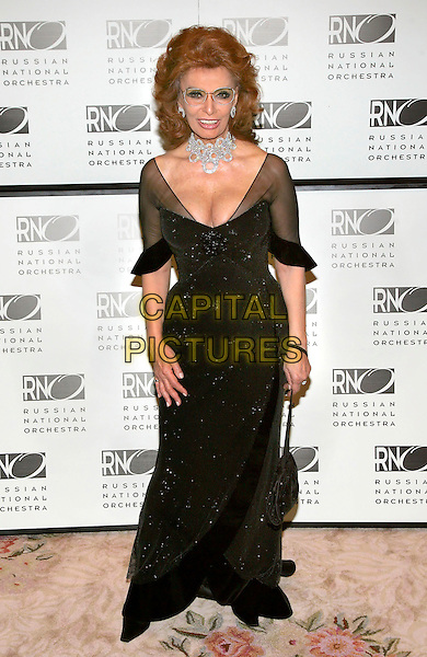 SOPHIA LOREN.At the Russian National Orchestra's 15th Anniversary Gala held at the St. Regis Hotel, New York, NY,.7th March 2006..full length black dress glasses low cut dress cleavage.Ref: ADM/JL.www.capitalpictures.com.sales@capitalpictures.com.©Jackson Lee/AdMedia/Capital Pictures.