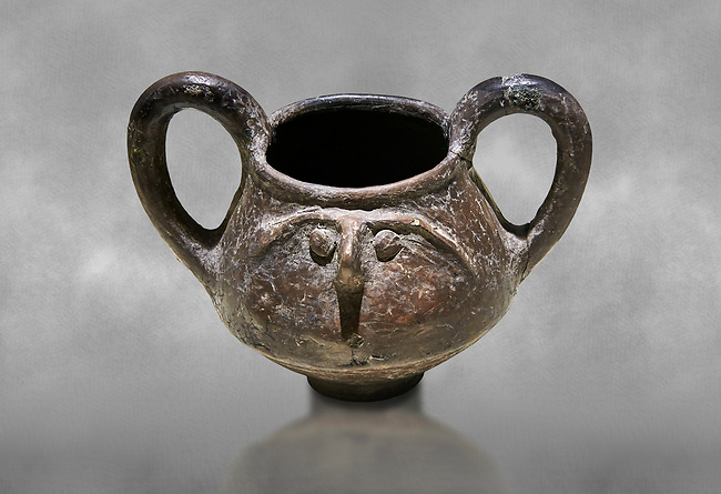 Hittite terra cotta double handled jug with a relief human face- 17th - 16th century BC - Hattusa ( Bogazkoy ) - Museum of Anatolian Civilisations, Ankara, Turkey . Against grey art background