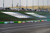 Matt Kenseth (#17) leads the field up the back straight.