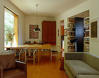 Despite the modern streamlined design of the house the dining room/home office is comfortably furnished
