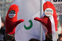 Moscow, Russia, 10/03/2012..A woman waves anti-Putin badges as up to 20,000 people protest in central Moscow against Vladimir Putin's victory in the Russian presidential election.
