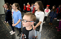 NWA Democrat-Gazette/DAVID GOTTSCHALK Caleb Osborne, a sixth grade student at Holt Middle School, practices singing Seventy-Six Trombones Monday, February 12, 2018, during practice with other students before auditions at the school in Fayetteville. The students are auditioning for The Music Man Kids musical. This year marks the 18th year for a musical at the school. Auditions will be held today also.