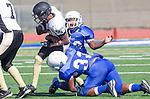 Culver City, CA 09/12/13 - Emilio Nunziati (Peninsula #9) and unidentified Culver City player(s) in action during the Peninsula vs Culver City Junior Varsity game at Culver City High School.