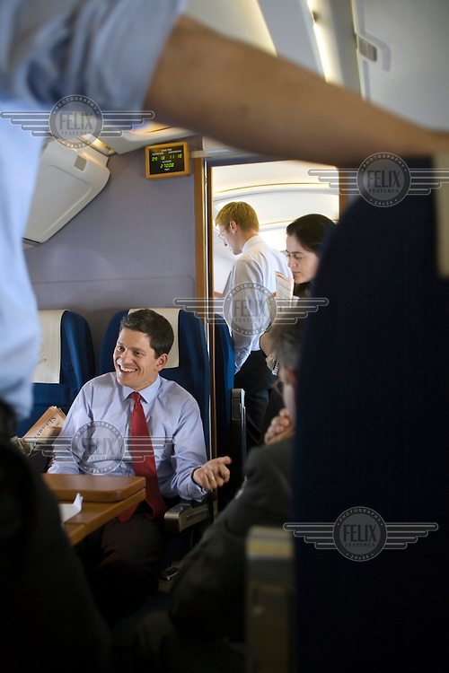David Miliband, Foreign and Commonwealth Secretary, with his staff on board the Queen's flight bound for talks with the Ukranian government.