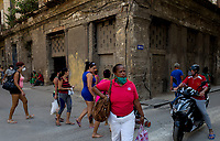 HAVANA, CUBA - MARCH 25: People wear face mask  to prevent the spread of COVID-19 in Old Havana, on March 25, 2020. The World Health Organization declared a global pandemic as the coronavirus rapidly spreads across the world.(Photo by Eliana Aponte/VIEWpress/Corbis via Getty Images)