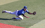 Wildcats' David Modler makes a diving catch against Salt Lake Community College at Western Nevada College in Carson City, Nev., on Thursday, March 5, 2015. <br /> Photo by Cathleen Allison/Nevada Photo Source