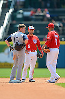 Buffalo Bisons second baseman Jim Negrych #5 and shortstop Ryan Goins #3 talk with Gordon Beckham #16 during a game against the Charlotte Knights on May 19, 2013 at Coca-Cola Field in Buffalo, New York.  Buffalo defeated Charlotte 11-6.  (Mike Janes/Four Seam Images)