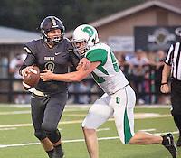 Danville defensive end Rhett Sullivan sacks Charleston quarterback Jackson Rowland in the first half of Friday's footbal game in Charleston.
