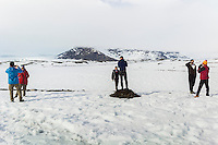 Fjallsarlon, Iceland - Tourists take pictures at Fjallsarlon, Iceland, March 2016. Fjallsarlon is a glacier lake at the south end of the Icelandic glacier Vatnajokull.