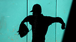 CARY, NC - MARCH 03: The late afternoon sun casts the shadow of a pitcher warming up on the wall of the bullpen. The University of Maryland Terrapins played the University of Notre Dame Fighting Irish on March 3, 2017, at USA Baseball NTC Stadium Field in Cary, NC in a Division I College Baseball game, and part of the Irish Classic tournament. Maryland won the game 4-3.