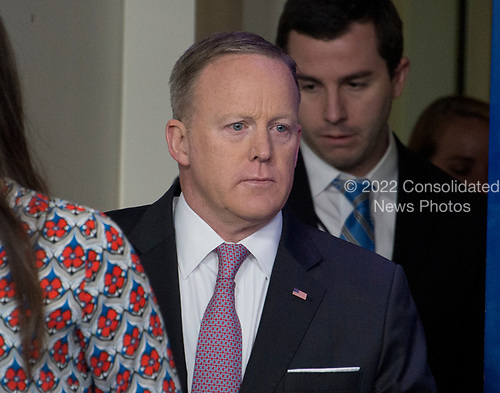 White House Press Secretary Sean Spicer arrives to conduct his Daily Briefing in the Brady Press Briefing Room of the White House in Washington, DC on Thursday, April 13, 2017.<br /> Credit: Ron Sachs / CNP