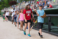 "Students who achieved ""Reading All-Stars"" status had the opportunity to parade around the warning track prior to the South Atlantic League baseball game between the Kannapolis Intimidators and the Hickory Crawdads against the Hickory Crawdads at Kannapolis Intimidators Stadium on April 22, 2017 in Kannapolis, North Carolina.  The Intimidators defeated the Crawdads 10-9 in 12 innings.  (Brian Westerholt/Four Seam Images)"