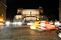 Traffic circles the Piazza Venezia in front of Altare della Patria (Altar of the Fatherland) on Tuesday, Sept. 22, 2015, in Rome, Italy. (Photo by James Brosher)