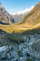 Scenic Milford Road through Darran Mountains near Hommer Tunnel, Fiordland NP, Southland, New Zealand