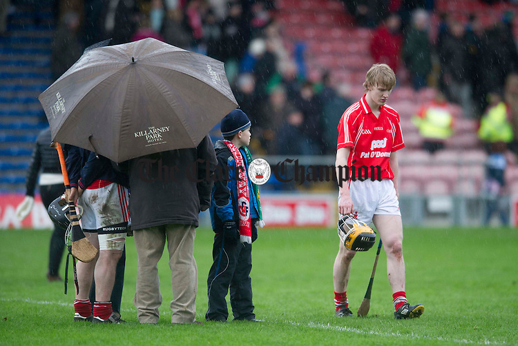 A dejected Gearóid O' Donnell leaves the field. Photograph by Declan Monaghan
