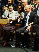 "First lady Michelle Obama (L) comforts NASA astronaut Mark Kelly, husband of United States Representative Gabrielle Giffords (Democrat of Arizona), at the event ""Together We Thrive: Tucson and America"" honoring the January 8 shooting victims at McKale Memorial Center on the University of Arizona campus on Wednesday, January 12, 2011 in Tucson, Arizona. The memorial service is in honor of victims of the mass shooting at a Safeway grocery store that killed six and injured at least 13 others, including U.S. Representative Gabrielle Giffords (Democrat of Arizona), who remains in critical condition after being shot in the head. Among those killed were U.S. District Judge John Roll, 63; Giffords' director of community outreach, Gabe Zimmerman, 30; and 9-year-old Christina Taylor Green..Credit: Kevork Djansezian / Pool via CNP"