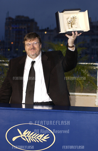 MICHAEL MOORE with his Palme d'Or award which he won for the best picture at the 57th Cannes Film Festival..May 22, 2004