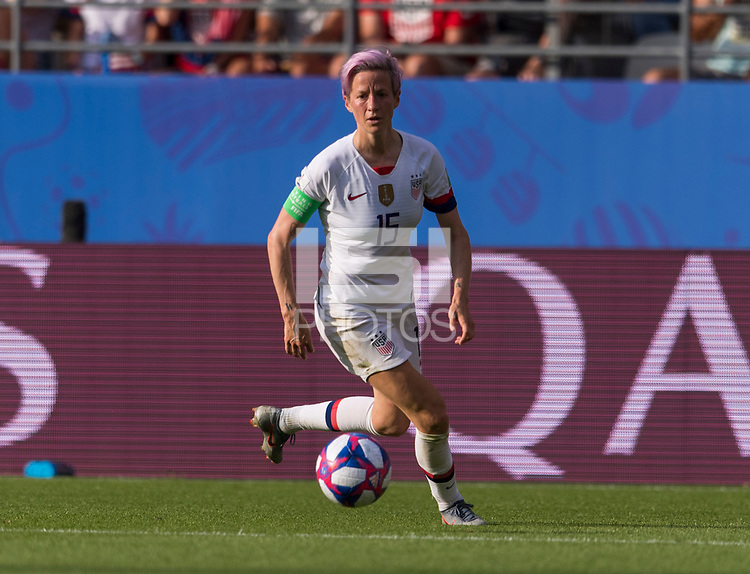 REIMS,  - JUNE 24: Megan Rapinoe #15 dribbles during a game between NT v Spain and  at Stade Auguste Delaune on June 24, 2019 in Reims, France.