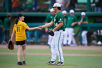 Young fan shakes hands with Julio Cortez (14) after throwing out a ceremonial first pitch before a USF Bulls game against the Dartmouth Big Green on March 17, 2019 at USF Baseball Stadium in Tampa, Florida.  USF defeated Dartmouth 4-1.  (Mike Janes/Four Seam Images)