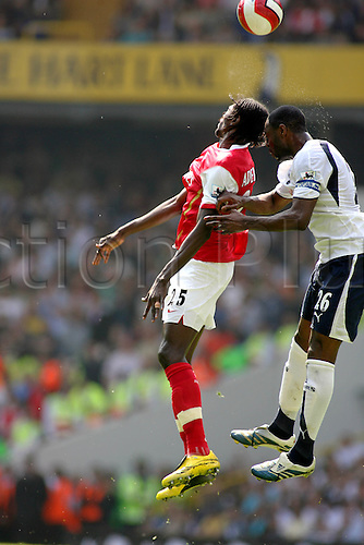 21 April 2007: Arsenal striker Emmanuel Adebayor jumps for the ball with Ledley King during the Premiership game between Tottenham Hotspur and Arsenal, played at White Hart Lane. The game ending 2-2. Photo: Actionplus....070821 football soccer player header