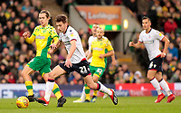 Bolton Wanderers' Joe Williams vies for possession with Norwich City's Todd Cantwell<br /> <br /> Photographer David Shipman/CameraSport<br /> <br /> The EFL Sky Bet Championship - Norwich City v Bolton Wanderers - Saturday 8th December 2018 - Carrow Road - Norwich<br /> <br /> World Copyright &copy; 2018 CameraSport. All rights reserved. 43 Linden Ave. Countesthorpe. Leicester. England. LE8 5PG - Tel: +44 (0) 116 277 4147 - admin@camerasport.com - www.camerasport.com