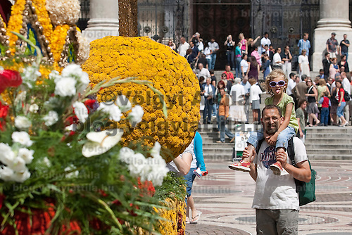 Visitors look at flower creations during the advertising festival of the Debrecen Flower Carnaval held at St Steven square in Budapest, Hungary. Saturday, 11. July 2009. ATTILA VOLGYI