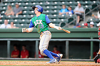 First baseman Frank Schwindel (13) of the Lexington Legends bats in a game against the Greenville Drive on Sunday, April 27, 2014, at Fluor Field at the West End in Greenville, South Carolina. Greenville won, 21-6. (Tom Priddy/Four Seam Images)