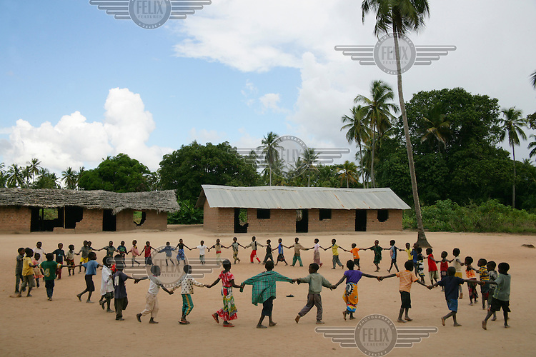Children playing outside at a community school.